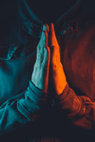 Praying hands of religious person