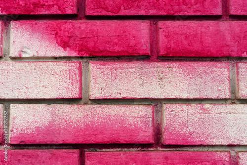 Różowa malująca ściana z cegieł tekstura