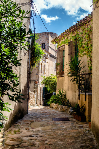 Street in the old town of Tossa de Mar, Spain. - 201221647