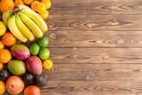 Colorful border of assorted fresh tropical fruit