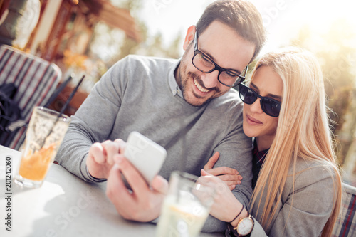 Young couple relaxing together in cafe