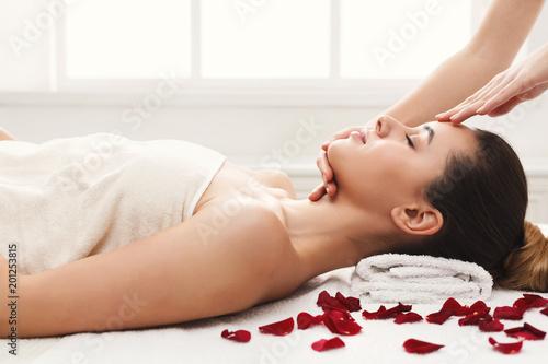 Foto Murales Woman getting professional facial massage at spa