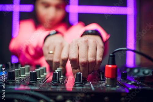 DJ playing music mixer closeup - 201254698