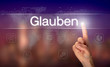 "A businessman pressing a Believe ""Glauben"" button in German on a futuristic computer  display"