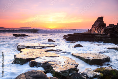 amazing sunset landscape at rocky beach