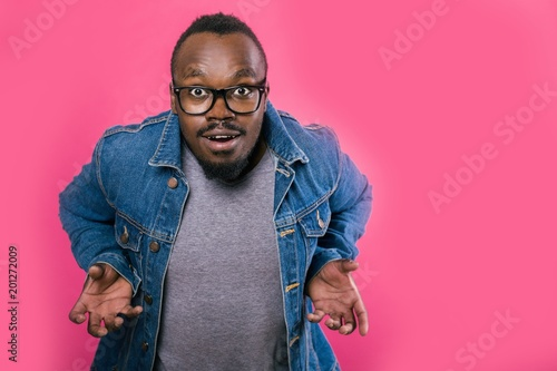 African a threatening posture stands on a pink background - 201272009