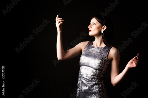 Foto Murales Fashion woman with red lipstick on black background.