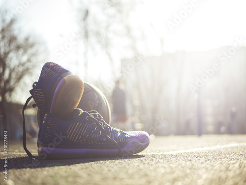 basketball sport shoes and playing ball close up on a sunny day