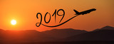New year 2019 by flying airplane on the air at sunrise, banner