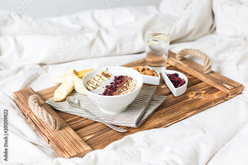 Poster Chia pudding with nuts and fruits. Breakfast in bed on a tray. View from above.