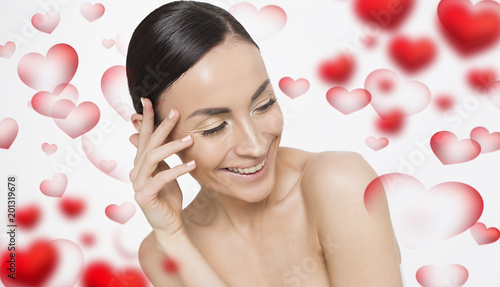 Foto Murales Beautiful young smiling woman with a clean and fresh skin posing on colorful background. Beauty and spa. Face and body care. Women's health. Cosmetology.
