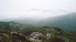 Aerial View With Mountain Road And Heavy Mist At The Background  - 201320897