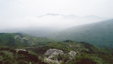 Aerial View With Mountain Road And Heavy Mist At The Background