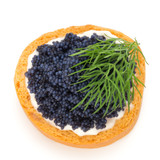 Canapes with black sturgeon caviar and  dill. Isolated on the white background. - 201323648