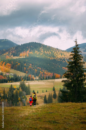 Mom and her kid at Carpathian countryside in Autumn.