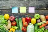 Top view of sticky notes with fruits and vegetables on the old wood table with copy space - 201335861