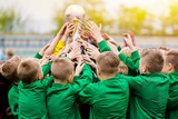 Kids Celebrating Soccer Victory. Young Football Players Holding Trophy. Boys Celebrating Sports Championship. Winning Team of Sport Tournament for Kids Children