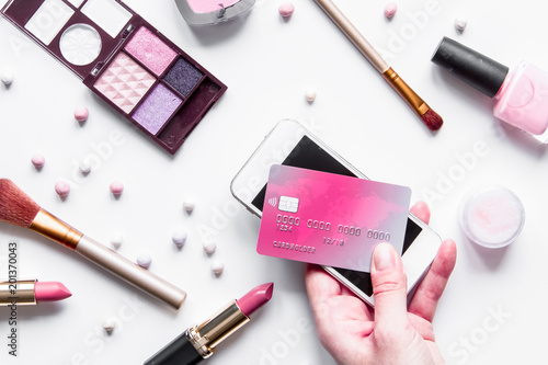 Foto Murales concept online shopping cosmetics on white background top view