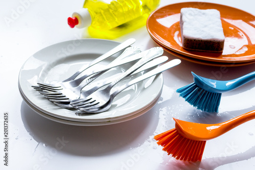 Foto Murales concept of washing dishes on white background