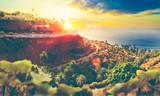 Paisaje pintoresco de atardecer.Idilico  acantilado en Tenerife.Gran Canaria.Mar y vegetacion con palmeras.