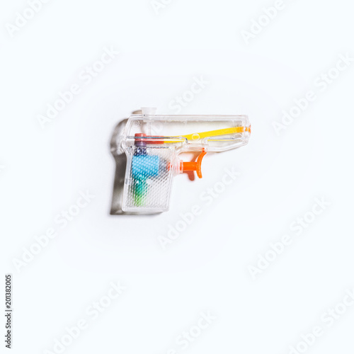 Clear Plastic Squirt Gun on a Bright White Background © ScottNorris