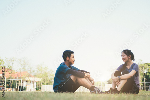 Sport young couple relaxing after physical training session.