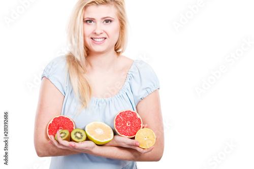 Woman holding fruits kiwi. orange, lemon and grapefruit - 201392686