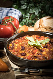 Chili con carne in a clay pan. - 201405452
