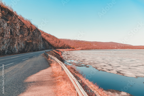 Spring day at the road to Utsjoki Finland with ice still on the lake - 201410648