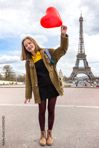 Sticker girl on the background of the Eiffel Tower