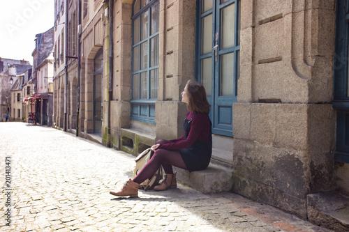 Foto Murales girl is walking in the old town Morlaix