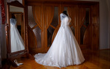 elegant wedding dress by the mirror
