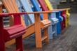 A row of colored muskoka chairs