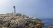 A panoramic of Peggy's Cove Lighthouse with the rocks in the foreground