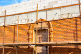 Construction of an old-style building with arched windows