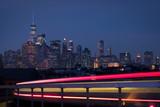 Lower Manhattan skyline with light streams in foreground