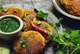 Alu Ki Tikki /  Potato (Aloo) Patties served with cilantro chutney - 201436239
