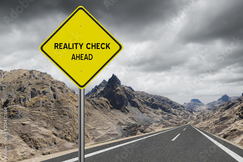 Reality Check Ahead sign