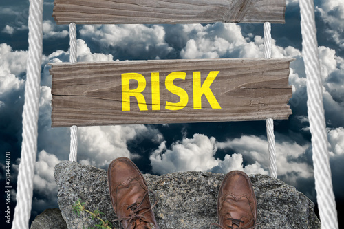 Challenging bridge with text Risk