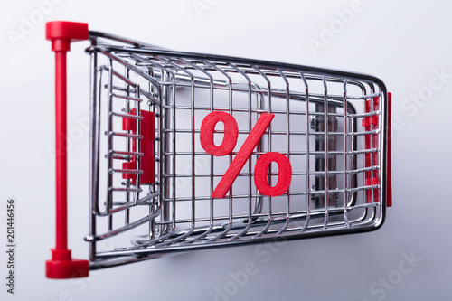 Foto Murales Shopping Cart With Red Percentage Sign