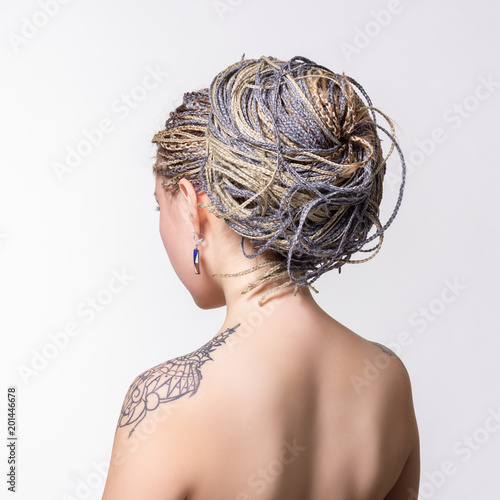 Womens hair with small braids. © papa