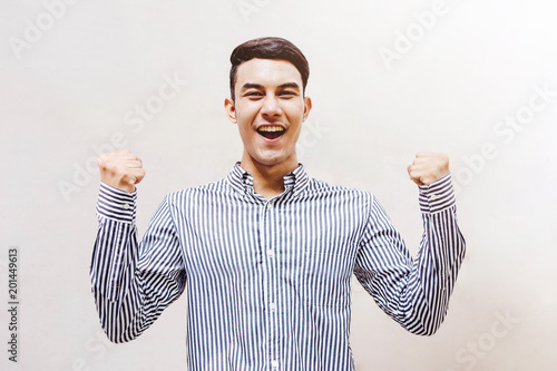 Young and Happy Businessman in Cheerful posture to Celebrate his Success Life, Successful and Business Achievement concept
