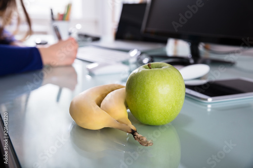 Close-up Of Bananas And Green Apple
