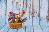 flowers in bamboo basket on wood background - 201462819