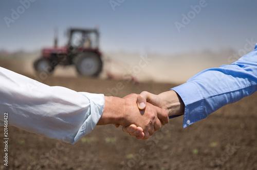 Aluminium Trekker Farmers shking hands in front of tractor