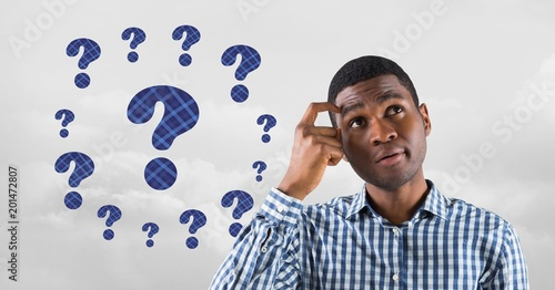 Man thinking with blue thatched question marks