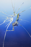 Broken blue glass window - 201476057