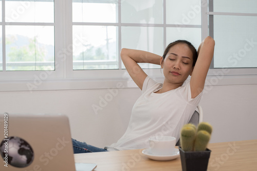 Woman relax on work table.