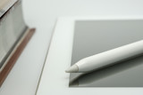 close up of digital pen on the white tablet - 201489401