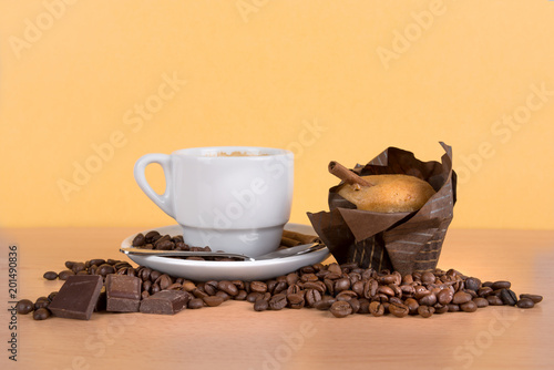 Wall mural coffee cup with beans and muffin